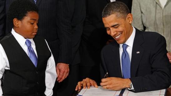 obama-signs-obamacare-16x9
